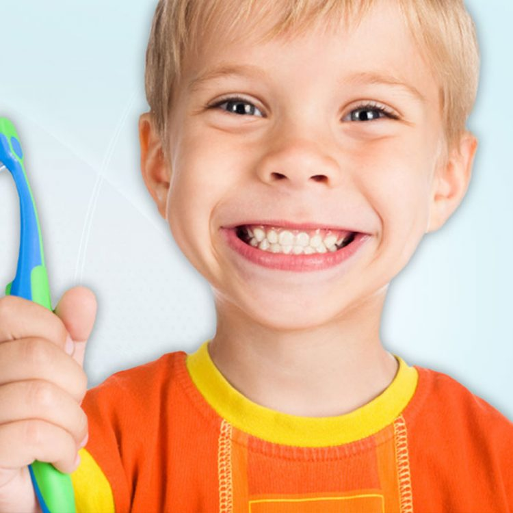 Kid holding toothbrush in his hand